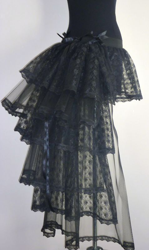 bustle. pretty. would look great over a sweeping skirt.