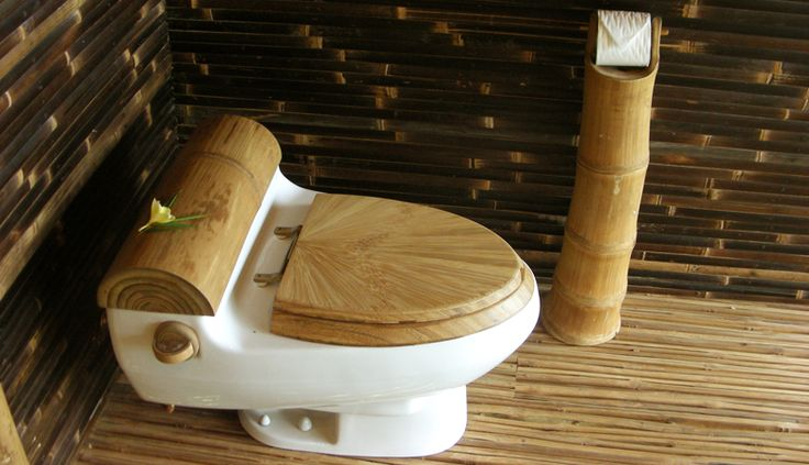 Hand carved bamboo toilet seat in the bathroom of a bamboo house.  Green Village, Bali.