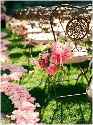 Isle wedding chair florals.