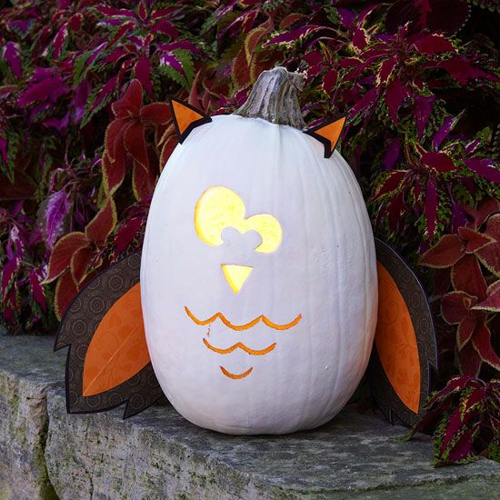 This adorable Halloween creation is crafted with just a bit of carving and colored papers.