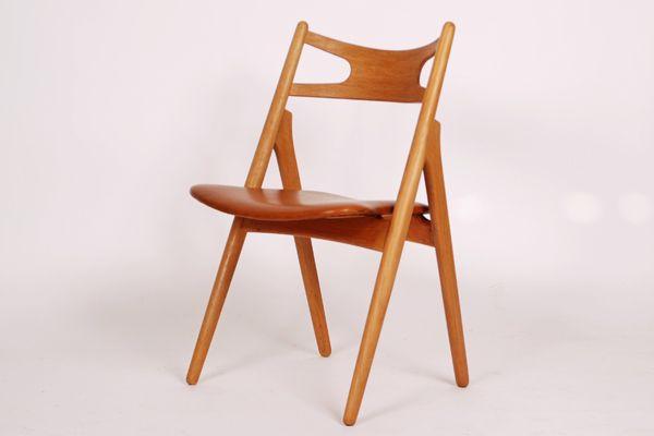 Hans J. Wegner chair Model CH29 in oak. With cognac leather. Produced by Carl Hansen
