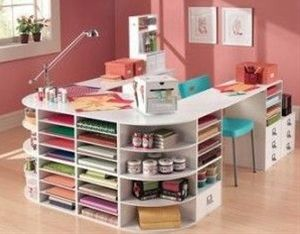 If your craft area is accessed through a doorway, install an organization rack that hangs on the inner side of the door. These wire racks present shelves of varying heights and are ideal for hugging clear containers of small art supplies, scrapbooking essentials and such gift-wrapping supplies as tags, bows and other package embellishments.
