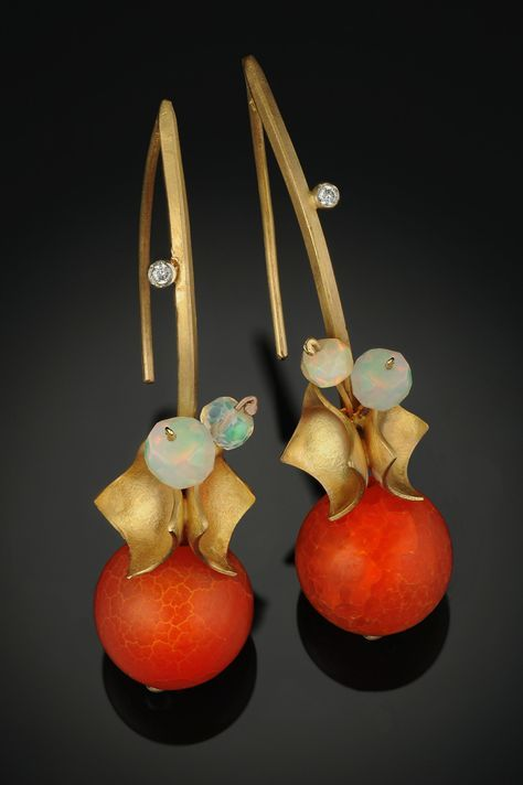 Pair these lovely earrings with either a casual or elegent look. Agate and Opal Earrings by Rosario Garcia. Gold & Diamond Earrings available at www.artfulhome.com