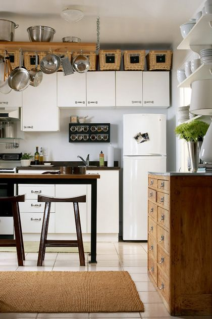 good idea: chests to fill empty space above cabinets: