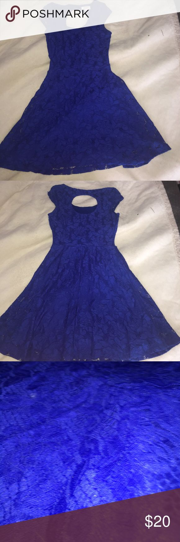 Electric Blue dress Beautifully fitted with a circular cut out in the back. Gorgeous lace flower pattern. Super comfortable and perfect for formal events! Any questions please ask! Candie's Dresses Midi