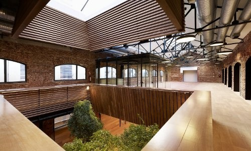 Top view of the Botin Foundation, double-height lobby with wooden lantern under the main skylight in American red oak