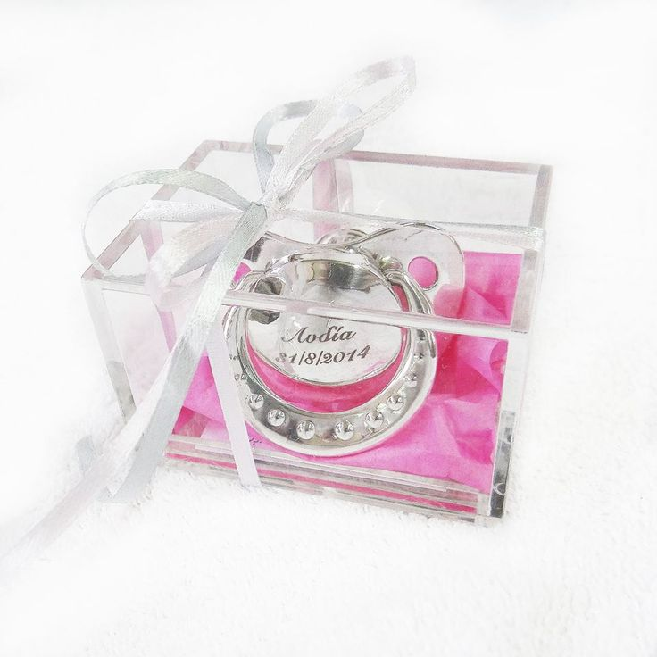 Baby pacifier coated with silver with engraving with a name and a date of birth.