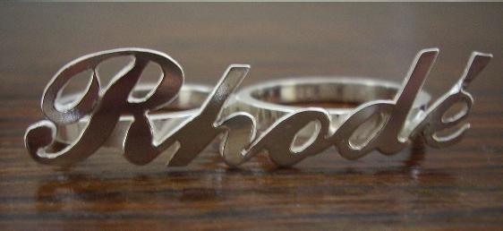 Naamring, dubbele ring van zilver.