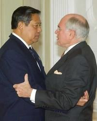 John Howard hugs Indonesian President Susilo Bambang Yudhoyono.