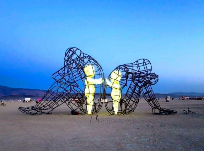 The most powerful sculpture of Burning Man represents two adults after a fight. They've turned away from one another but their 'inner children' long to make up.