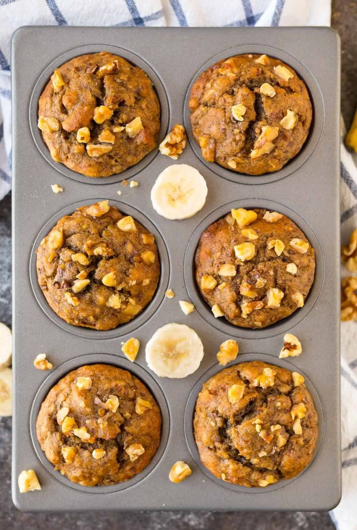 BEST Healthy Banana Muffins with Greek yogurt. An easy, one-bowl recipe that the whole family will love. These fluffy, healthy whole wheat banana muffins will be a hit for breakfast or snacks!