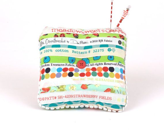 This little pincushion is so sweet....Pincushion Selvage Springtime Upcycle Floral by KarenGriskaQuilts, $25.00.. and I've been throwing out my selvages for years!
