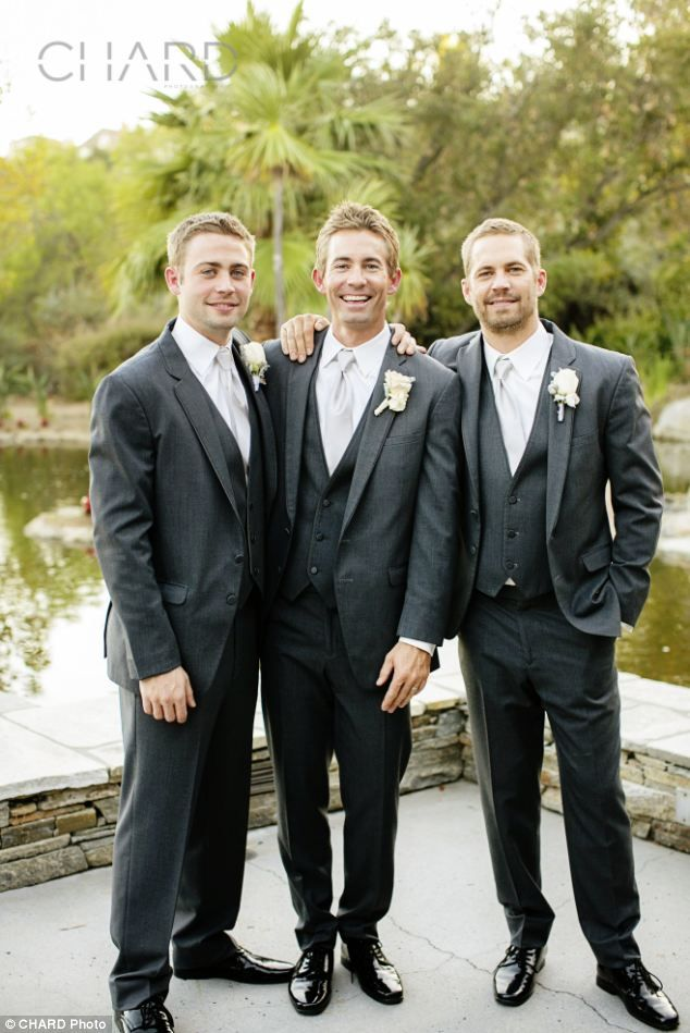'We welcome Paul's brothers into our FAST family': Cody (left) and Caleb (centre) - pictured here with their late brother at Caleb's October wedding - will 'help complete some remaining action and fill in small gaps left in production'