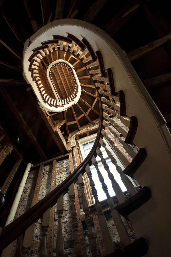 spiral staircase in an abandoned monastery