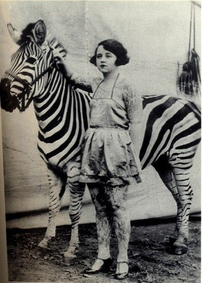 Tattooed woman with zebra.