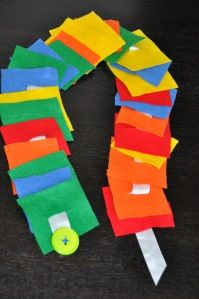 Button Snake: for kids who need practice with buttons. Cut the felt into squares (or fun shapes) Cut a small slit into each square (to fit your button) Sew one felt square near the end of your ribbon Sew a button onto the other end of your ribbon Choose larger or smaller button size for difficulty level. Make different shapes and colors if you want the kid to be able to create patterns.
