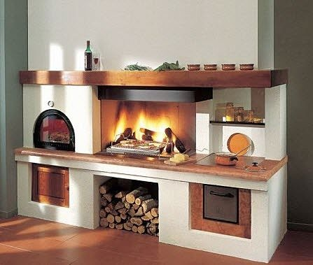 Cooking on an open fire indoors.