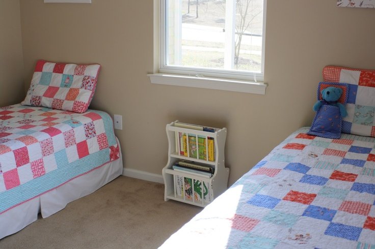 nice simple shared bedroom- boy and girl quilts made from fabric from same collection