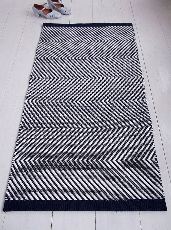 Width 80 cm (31 in) Length 150 cm (59 in)  Weight 3,1 kg  This rug is made to order only, please allow 3-4 weeks for making it. For custom sizes please contact me.  Materials navy blue and soft white cotton tricot, white cotton warp yarn. Weft material is upcycled textile manufacturing cotton