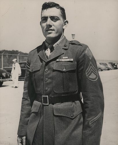 """John Basilone, Marine Headquarters, September 1943  """"Marine Congressional Medal of Honor Hero Platoon Sergeant John Basilone, USMC, recently visited the Marine Headquarters at Washington, DC. Pl. Sgt. Basilone's home is Raritan, NJ. He was awarded the Congressional Medal of Honor for """"extraordinary heroism and conspicuous gallantry in action above and beyond the call of duty."""""""""""