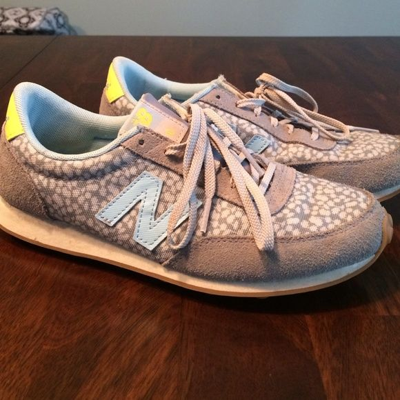 New Balance 410 Women's shoes A lightly worn pair of New balance shoes for women. Very stylish just a little dusty from being put away. Colors:,gray, light blue and bright yellow. Very cute! New Balance Shoes