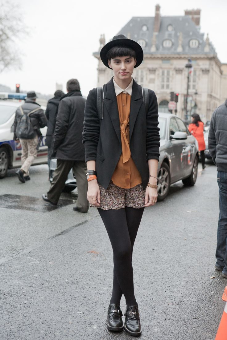 black blazer, caramel blouse, scalloped hem shorts, black tights, spiffy shoes and bowler hat.