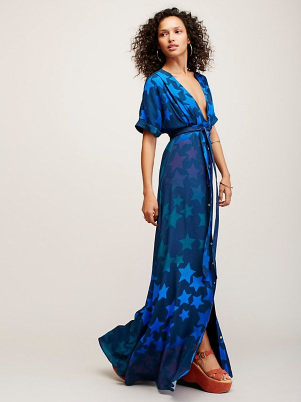 Star Tie Front Dress | Stunning maxi dress featuring an allover out-of-this-world star print. Plunging neckline with tie detail at the bust and subtle cutout at the waist for a peek of skin. Buttonup skirt and effortless, sweeping silhouette.
