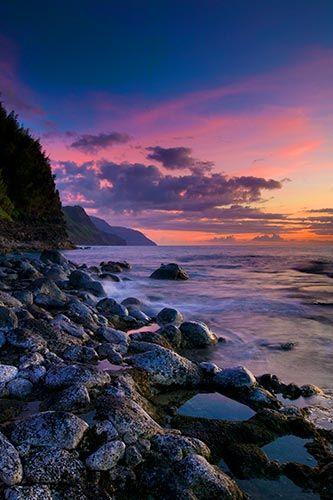 Sunset, Ke'E Beach, Kauai    A dramatic sunset colors the sky over Ke'E beach on the Hawaiian  island of Kauai. The beach overlooks the Na Pali Coast.