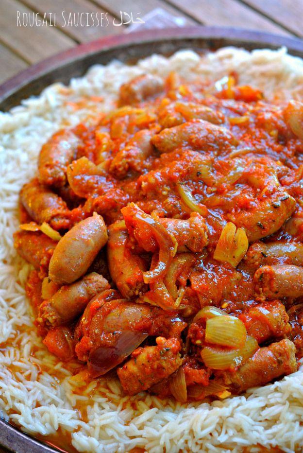 Rougail Saucisses. J'ai utilisé des saucisses fumées genre Diot gingembre tomates entre coulis et concassées curcuma