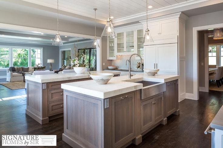 Love the look of the lower cabinets Well+appointed+transitional+kitchen+boasts+a+rift+sewn+oak+kitchen+island+topped+with+thick+Calacatta+white+marble+countertops+holding+a+stainless+steel+apron+prep+sink+and+high+arc+polished+nickel+gooseneck+faucet+illuminated+by+two+glass+cone+pendants.