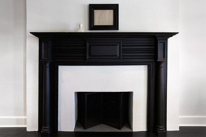 Black Fireplace Mantel - Transitional - living room - Sullivan Building and Design Group