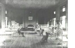 """Elizabeth General Medical Center and St. Elizabeth Hospital. Much has changed in Elizabeth General Medical Center's Pediatric Unit since this photo was taken in 1895. The area was called """"The Daisy Bed Ward"""" in memory of Eliza Gracie Halsey. Note how the fireplace at the end of the room served as an early incubator."""