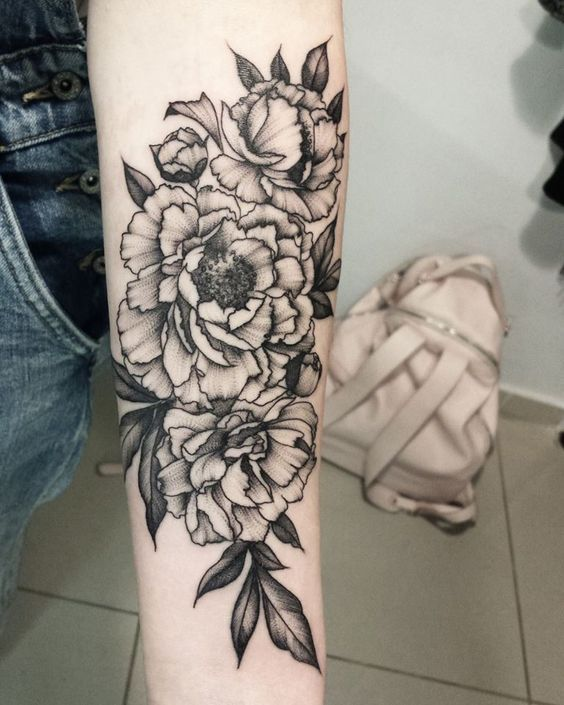 Cute arm flower arrangement. Click to discover more Sensational Flower Tattoos.