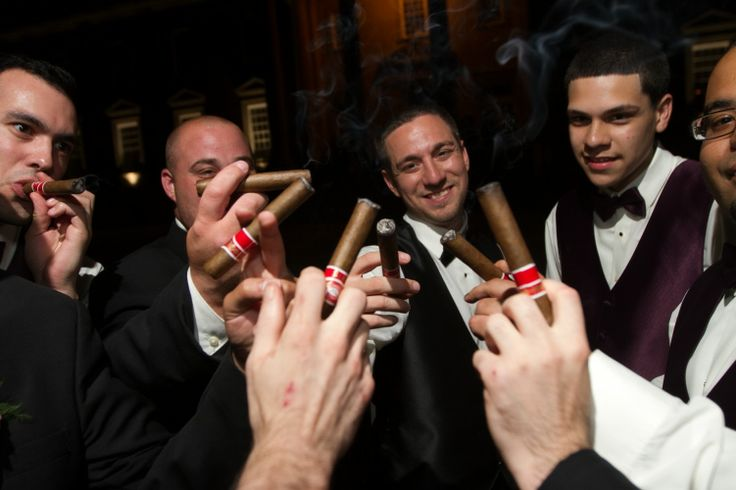 The groomsmen share some celebratory cigars. Thanks to Dartise Photography.