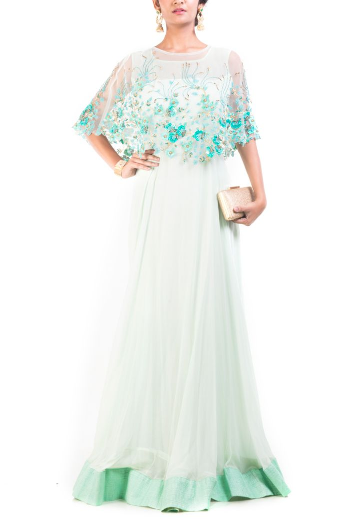 Featuring a floral embroidered, alice blue cape gown, with hem ends and cotton silk green border.  Cape has been intricately embroidered using sequins, beads and thread work
