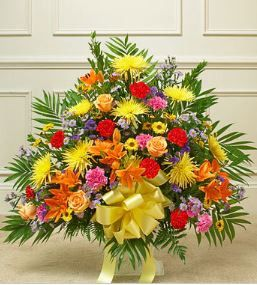 Heartfelt Tribute Bright Floor Basket Arrangement Share your most sincere expression of sympathy during a difficult time with this tasteful and elegant floor basket arrangement. Our expert florists ha