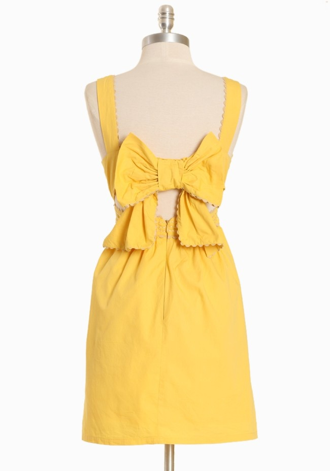 """Sunlight Soiree Bow-back Dress By Judith March 109.99 at shopruche.com. We love this sunny yellow dress with charming cream ric rac trim. The dress has two side pockets and an open back, which is accented with a bow. It has a padded bust, hidden back zipper, and the skirt is lined.  100% Cotton Imported Bust: 34"""" Waist: 26""""  32"""" length from top of shoulder *All measurements taken from a size Small"""