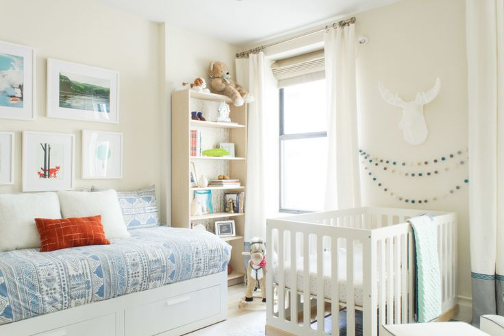 Peaceful modern nursery in New York with mountain murals in shades of blue-grey.