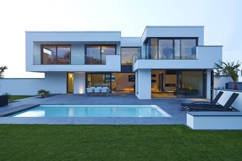 Luxury mansion modern home architecture exterior with swimming pool and lawn by LEE+MIR