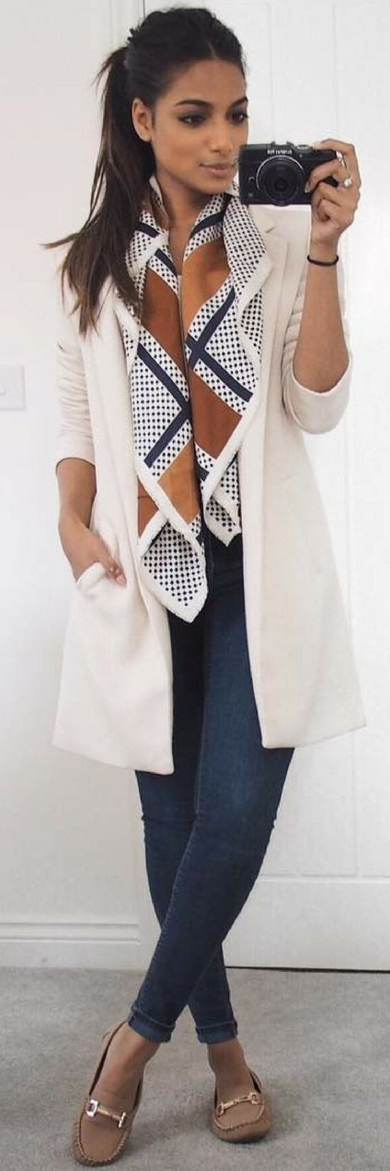 #fall #outfits women's whiet coat and blue jeans outfit