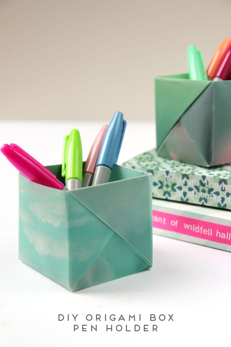 I love coming up with new ways to add a handmade touch to my desk. Lately it's been starting to look a little neglected and cluttered so I decided to make these origami box pen holders to help keep it