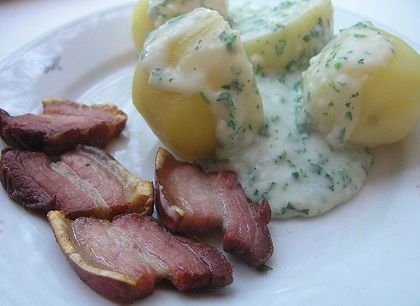 """Stegt flæsk"" - Fried slices of juicy pork on the bone with tasty Danish potatoes and creamy parsley sauce is one of the Danes favourite everyday dishes and is mostly eaten during the cold and wet winter periods."