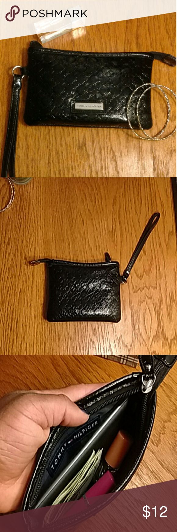 """TOMMY HILFIGER Embossed wristlet Crafted in vinyl embossed with TOMMY HILFIGER's logo, this spacious wristlet can hold lipstick, phone, cash, & more!    Versatile look makes it a perfect day-to-day night piece.   Item is in GREAT condition (was one of my favorite wristlets, so it has been taken care of).  Measurements: 4"""" tall & 7"""" wide Tommy Hilfiger Bags Clutches & Wristlets"""