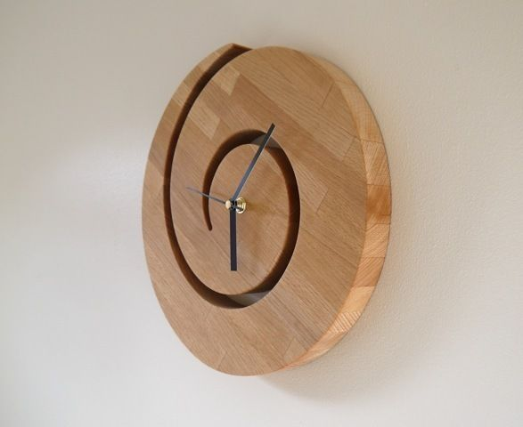 This solid wooden clock in the shape of a spiral sun will most definately be special accessory to your living room or kitchen.    This clock is mad...