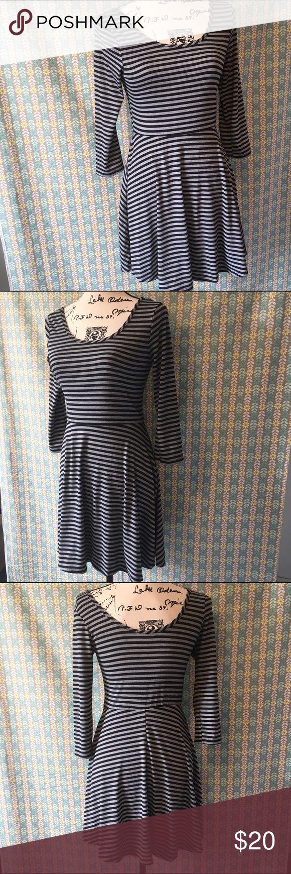 Delias skater dress. Medium Delias scoop neck skater dress. 3/4 sleeves with Black and grey stripes. Light rayon fabric with spandex waistband. Delias Dresses Mini