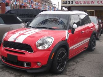 2012 Mini Cooper Country Man 'S' ALL4 - $22,995.00 Odometer:  76,595 km's  Doors:  4 Door   Engine:  4-Cylinder  Transmission:  Manual   Fuel Type:  -  Drive Type:  All Wheel Drive   Exterior Colour: Red  Interior Colour:  Beige   6 speed Manual Trans. Finished in Red with Beige leather. Navigation, panoramic roof, ipod and Bluetooth integration, heated seats, traction control, Car proof verified accident free. Price is plus H.S.T and licensing