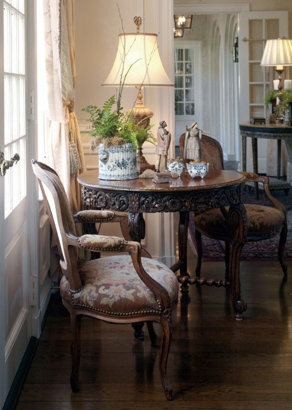 Knight-Carr...Lovely small table w/ traditional chairs displays some favorite collections.