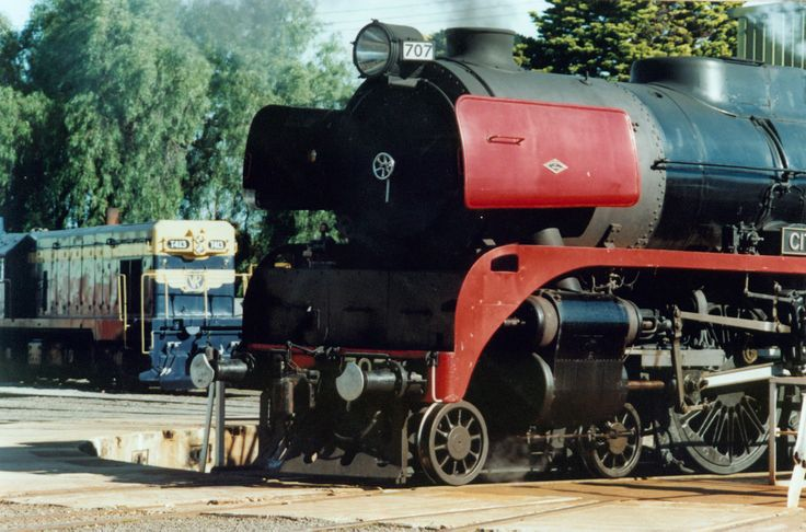 R 707, The City of Melbourne on the turntable at Geelong Loco with a series one T class in original V/R blue and gold in the background and not doing much of anything.