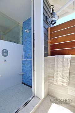 Everything about this indoor/outdoor shower combo screams coastal luxury. The interior is a mix of classic subway tile, marble mosaics and repose glass while the exterior is flanked in porcelain and wood to withstand the elements. www.cabochontile.com