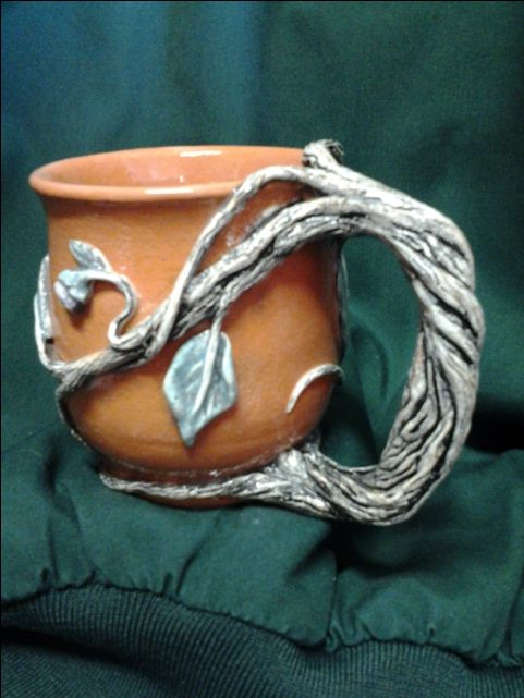 Thrown and altered clay mug blending terra cotta with white earthenware. Glazed clear, lead free, food safe.